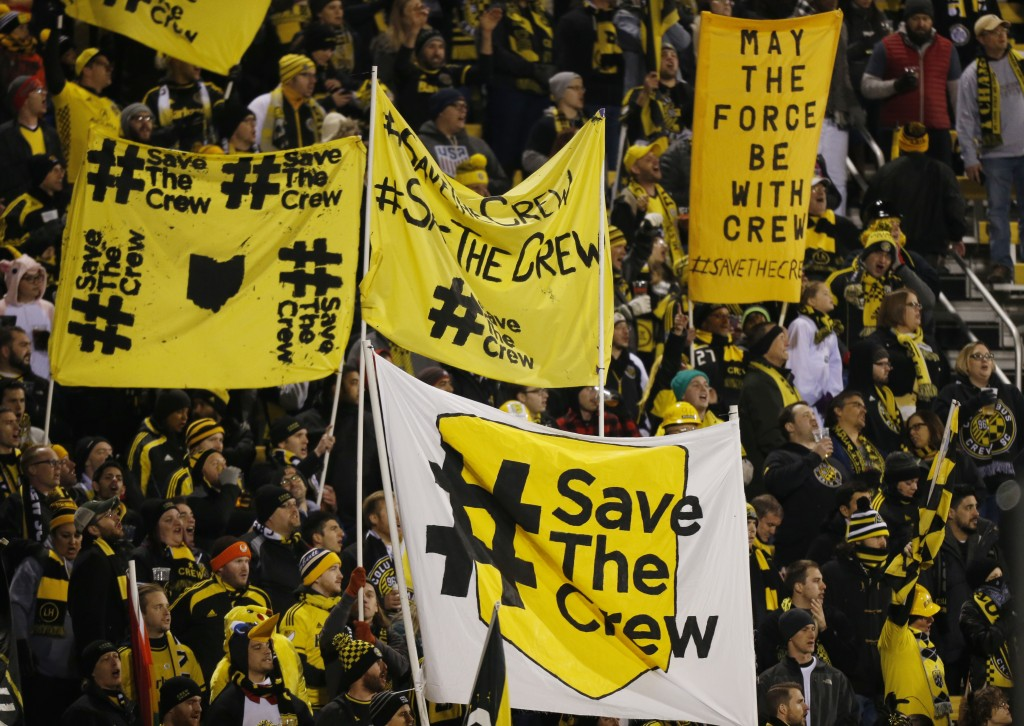 FILE - In this Oct. 31, 2017, file photo, Columbus Crew fans show their support for the team before the start of their MLS Eastern Conference semifina...