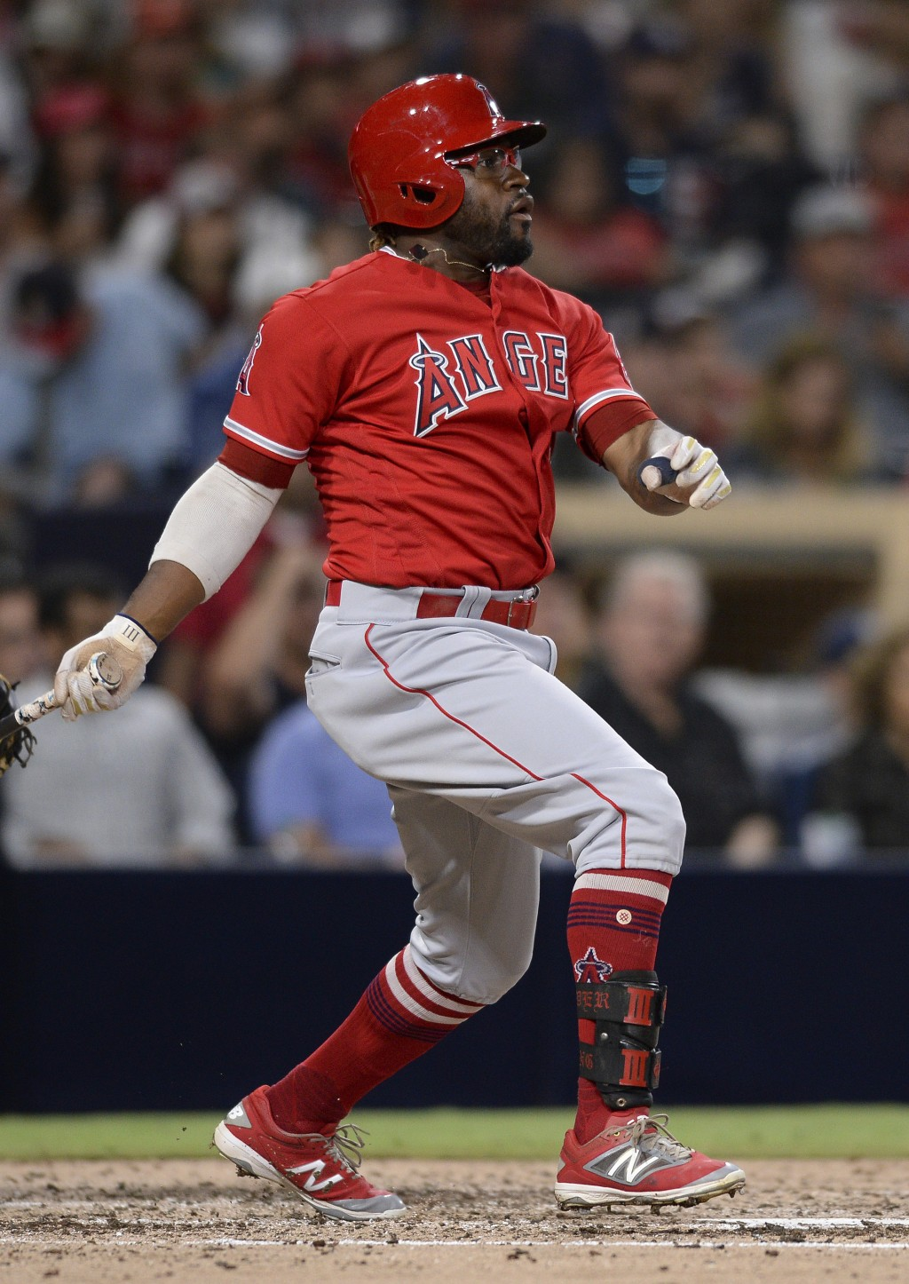 Los Angeles Angels' Eric Young Jr. watches his RBI triple during the fourth inning of a baseball game against the San Diego Padres Tuesday, Aug. 14, 2...
