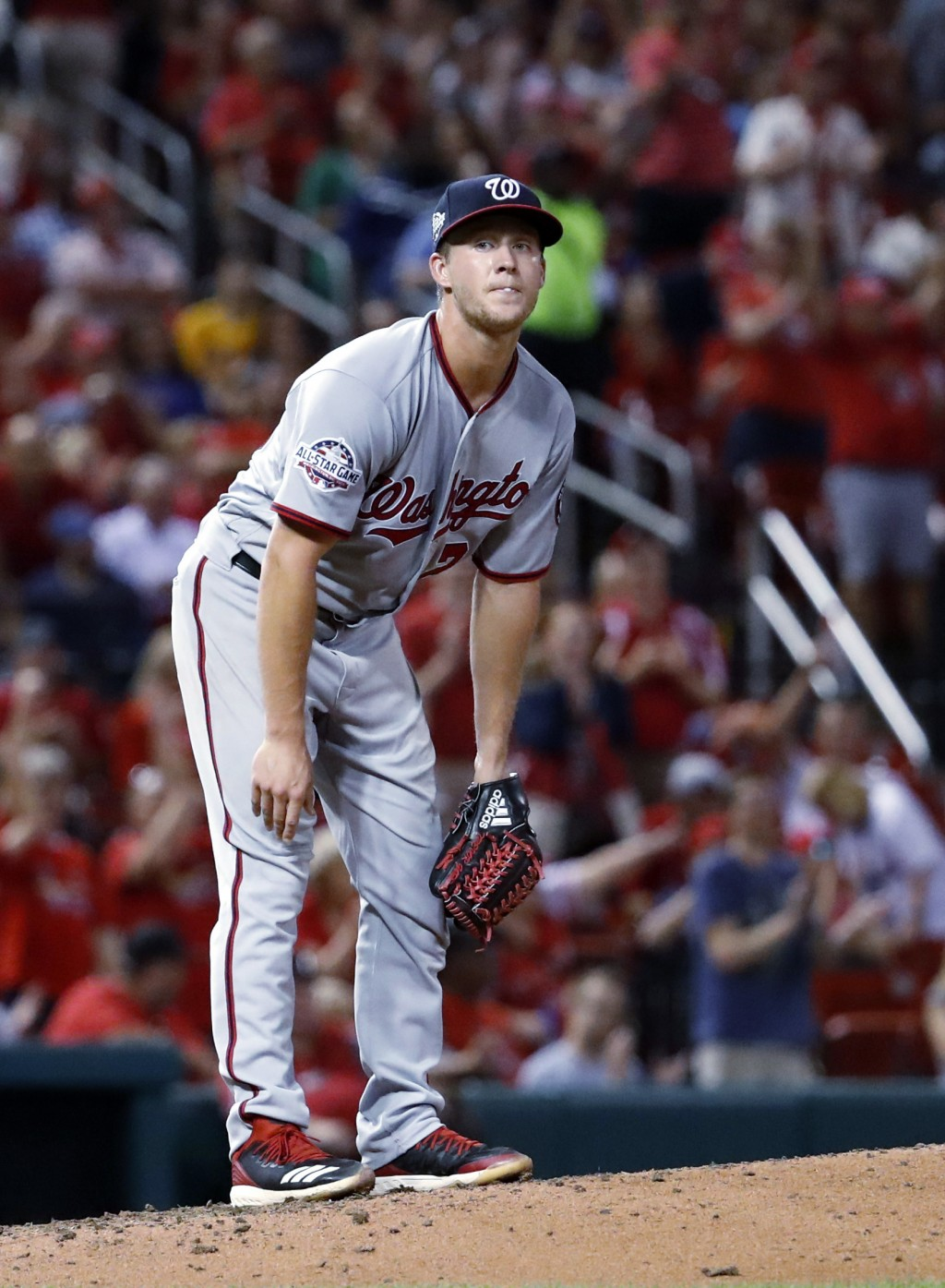 Washington Nationals relief pitcher Trevor Gott stands on the mound after giving up a solo home run to St. Louis Cardinals' Kolten Wong during the six...