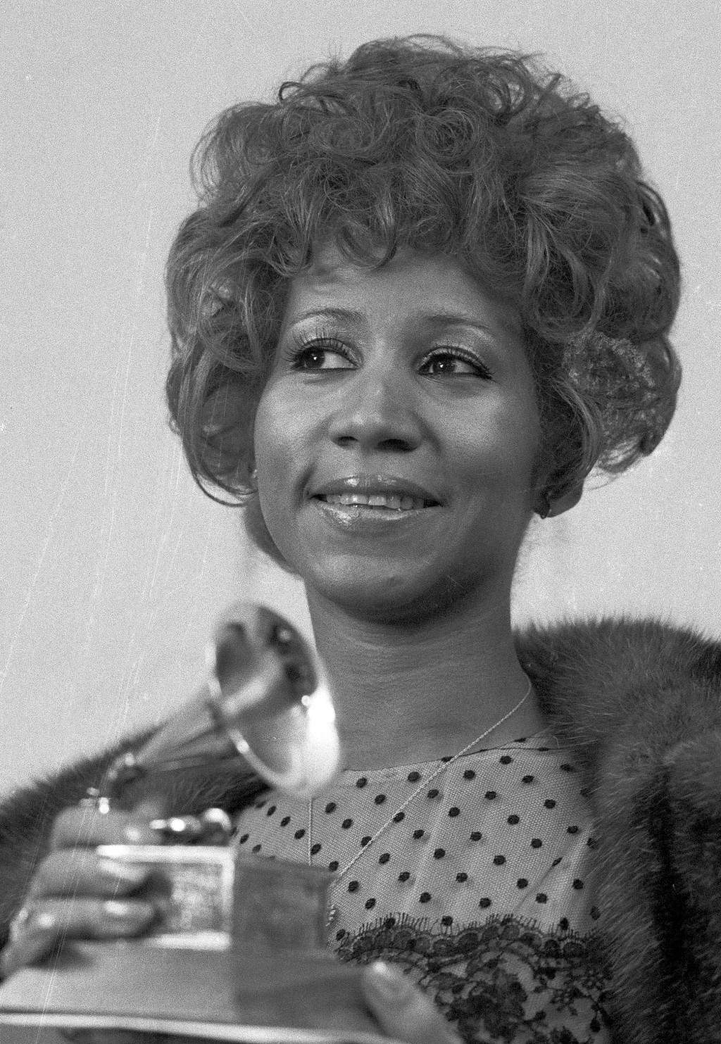 """FILE - In this March 13, 1972 file photo, Aretha Franklin holds her Grammy Award for Best Rhythm and Blue performance of the song """"Bridge Over Trouble..."""