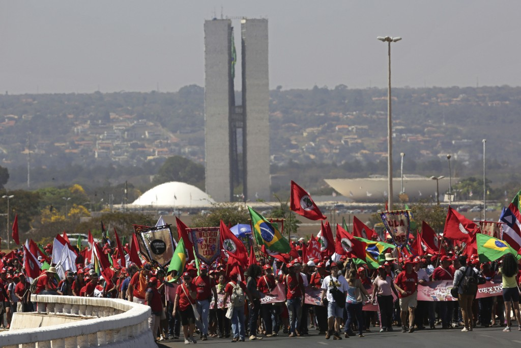 Supporters of Brazil's former president Luiz Inacio Lula da Silva begin their Free Lula March, in Brasilia, Brazil, Tuesday, Aug. 14, 2018. Thousands ...