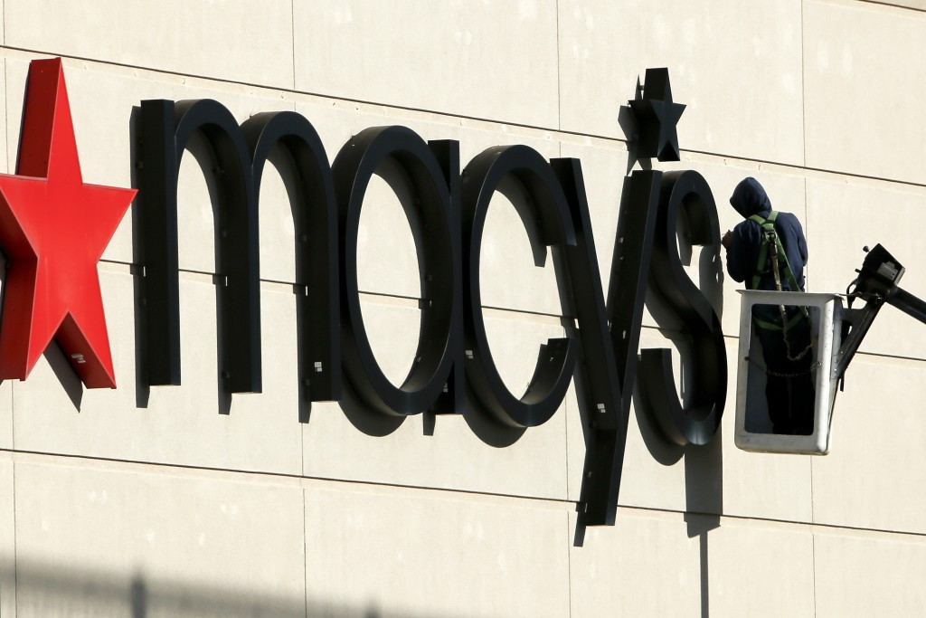 FILE- In this Feb. 12, 2018, file photo the sign on a Macy's store in Homestead, Pa., is worked on. Macy's Inc. reports earnings Wednesday, Aug. 15. (...