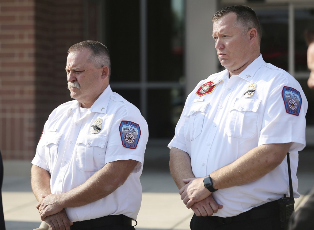Draper Battalion Chiefs Bart Vawdrey and Kevin Holt listen during a press conference in Draper, Utah, on Tuesday, Aug. 14, 2018. Draper Battalion Chie...