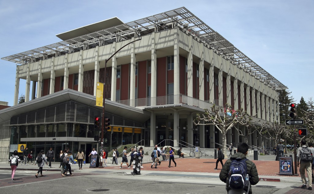 FILE- In this May 10, 2018, file photo students walk near the Martin Luther King Jr. Student Union building on the University of California at Berkele...