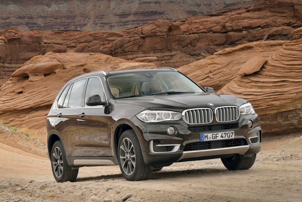 This undated photo provided by BMW shows the 2014 X5. The midsize X5 really set the standard for the current crop of road-focused luxury SUVs, blendin...