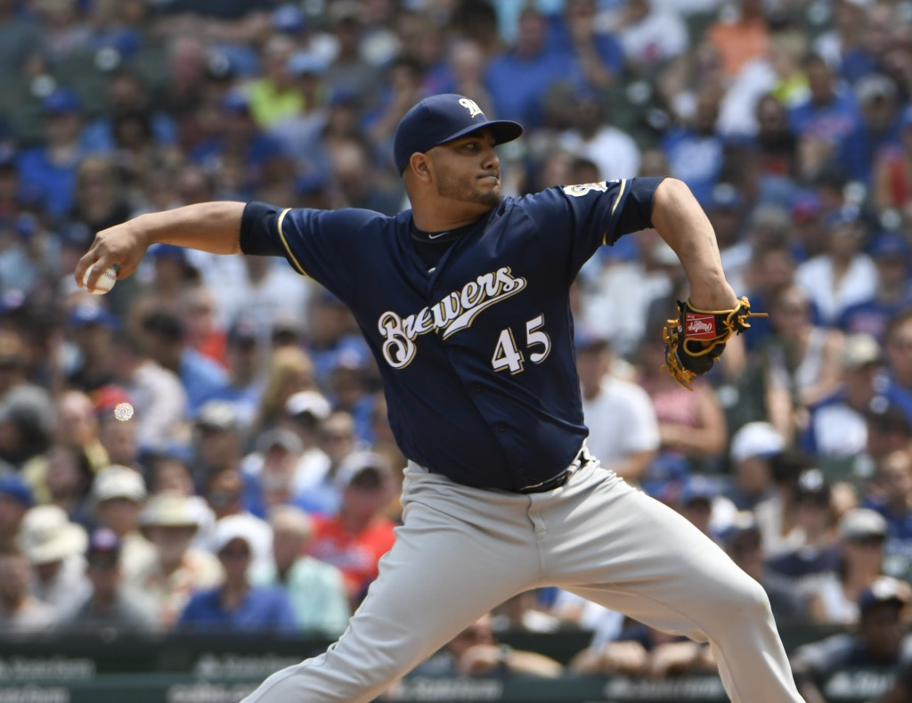 Milwaukee Brewers starting pitcher Jhoulys Chacin (45) throws the ball against the Chicago Cubs during the first inning of a baseball game,Tuesday, Au...