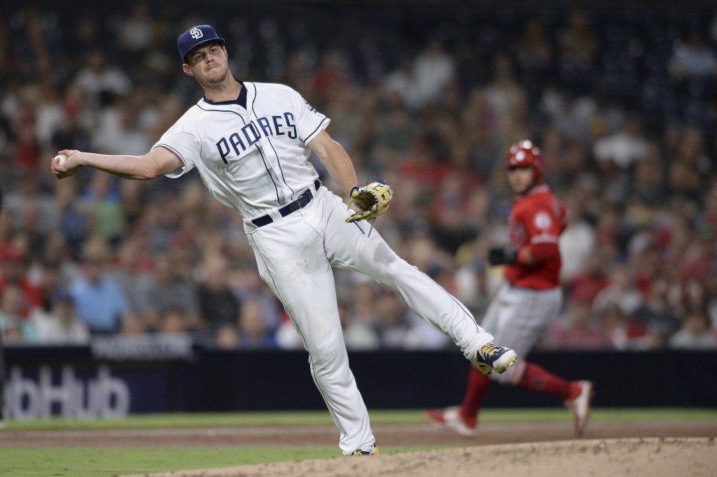San Diego Padres third baseman fielder Wil Myers throws to first base on a ground out by Los Angeles Angels' Andrelton Simmons during the third inning...