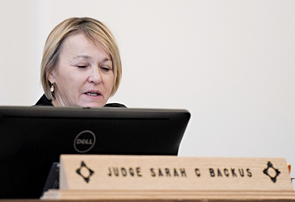 In this Monday, Aug. 13, 2018 photo, District Court Judge Sarah C. Backus presides over the hearing in the Amalia, N.M., desert compound case in Taos,...