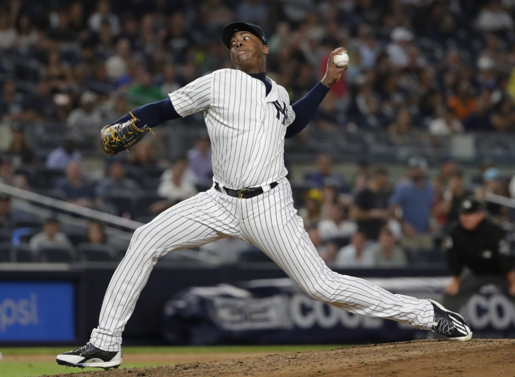 New York Yankees' Aroldis Chapman delivers a pitch during the ninth inning of a baseball game against the Tampa Bay Rays Tuesday, Aug. 14, 2018, in Ne...
