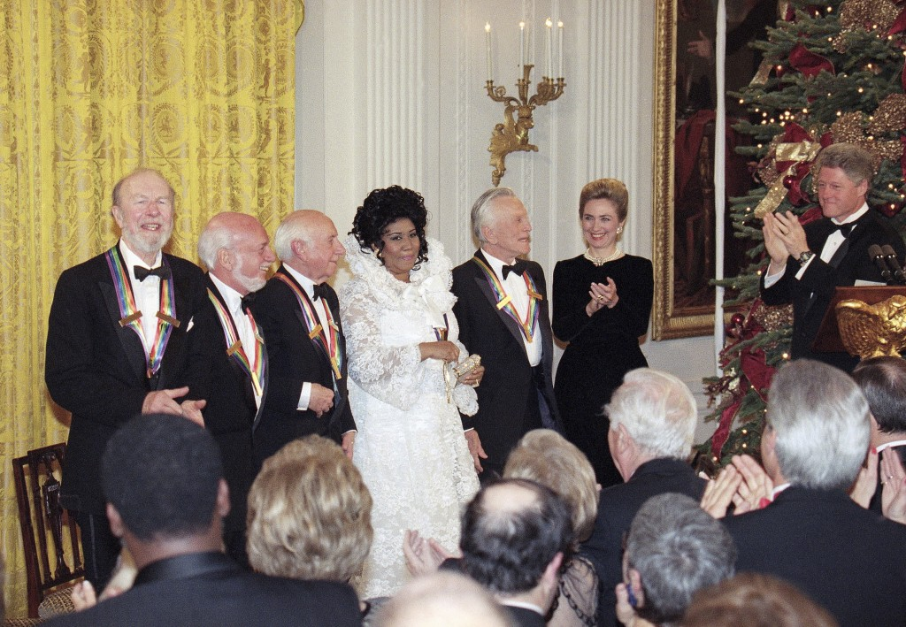 FILE - In this Dec. 4, 1994 file photo, President Bill Clinton, from right, and first lady Hillary Rodham Clinton applaud the 1994 Kennedy Center Hono...