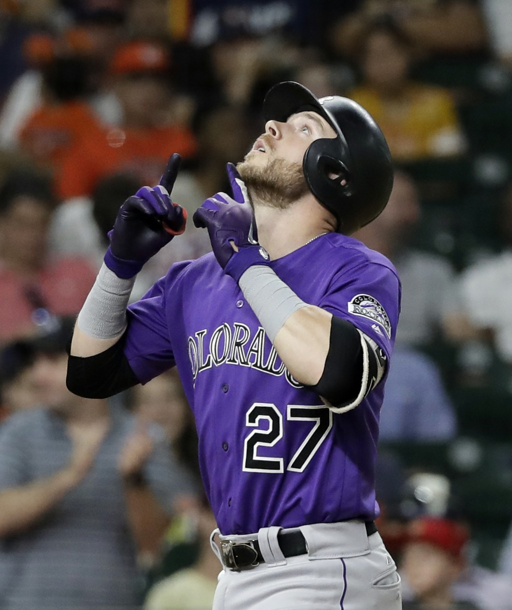 Colorado Rockies' Trevor Story (27) celebrates after hitting a home run against the Houston Astros during the eighth inning of a baseball game Tuesday...
