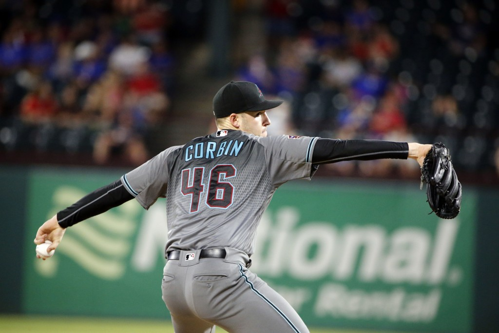 Arizona Diamondbacks starting pitcher Patrick Corbin (46) pitches against the Texas Rangers during the seventh inning of a baseball game Tuesday, Aug....