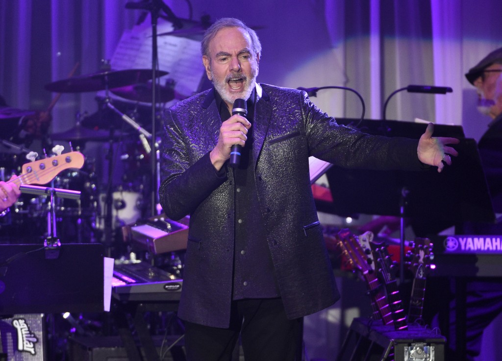 FILE - In this Feb. 11, 2017 file photo, Neil Diamond performs at the Clive Davis and The Recording Academy Pre-Grammy Gala in Beverly Hills, Calif. D...
