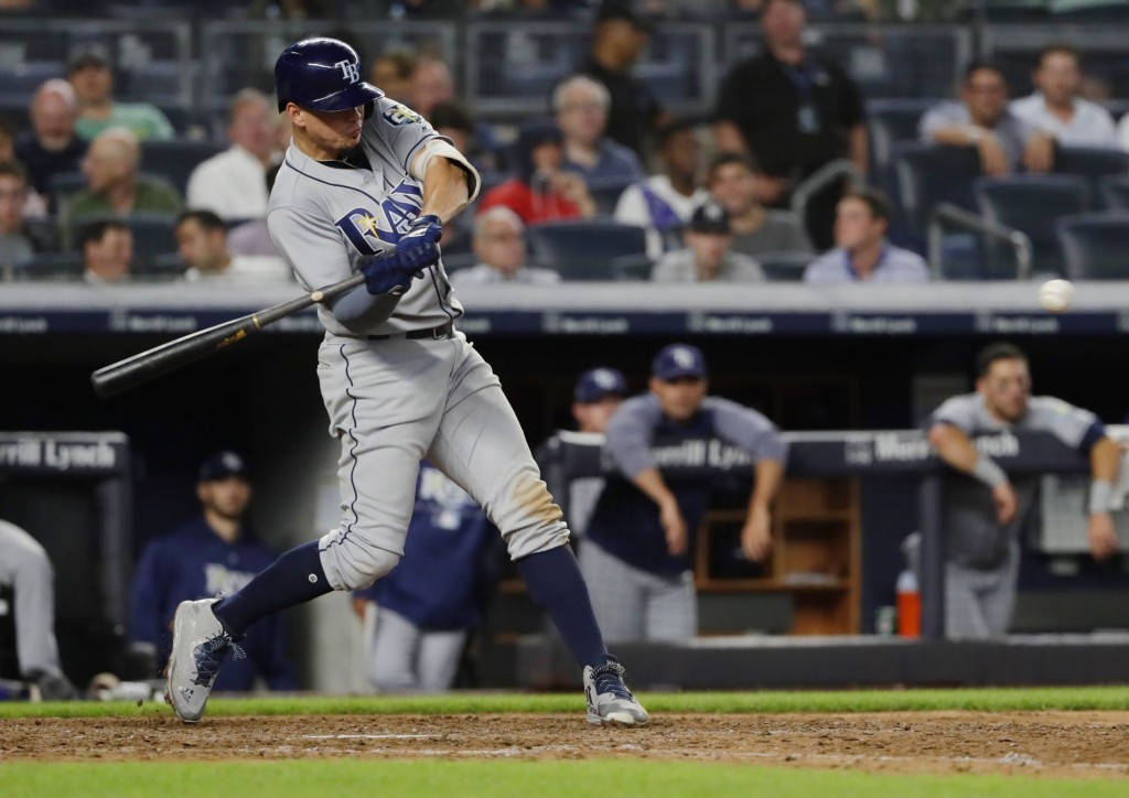 Tampa Bay Rays' Willy Adames hits a home run during the eighth inning of a baseball game against the New York Yankees Tuesday, Aug. 14, 2018, in New Y...