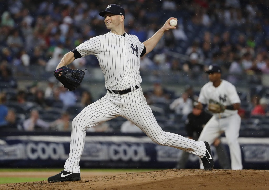 New York Yankees' J.A. Happ delivers a pitch during the first inning of a baseball game against the Tampa Bay Rays Tuesday, Aug. 14, 2018, in New York...