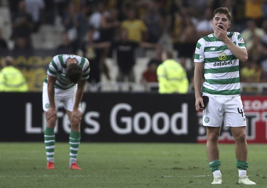 Celtic's James Forrest, right, reacts at the end of a Champions League third qualifying round, second leg, soccer match between AEK Athens and Celtic ...