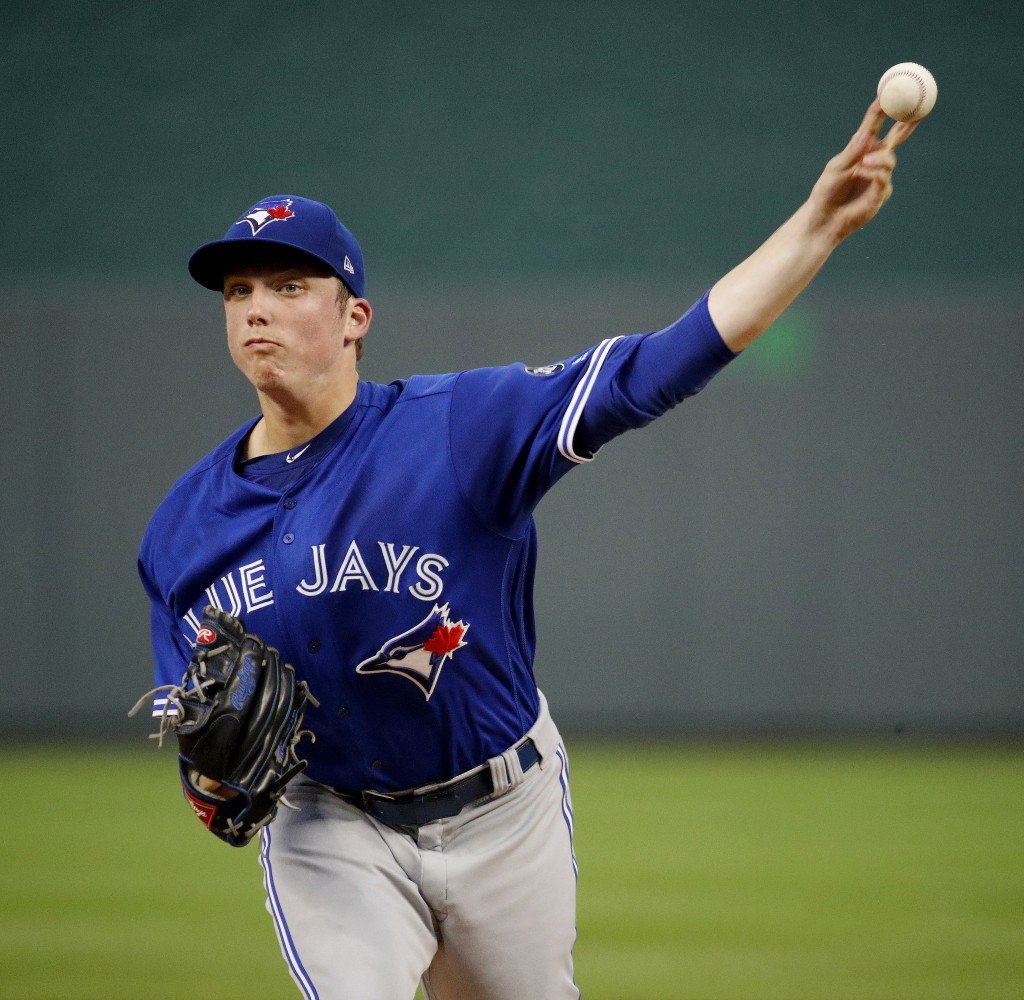 Toronto Blue Jays starting pitcher Ryan Borucki throws during the first inning of a baseball game against the Kansas City Royals Tuesday, Aug. 14, 201...