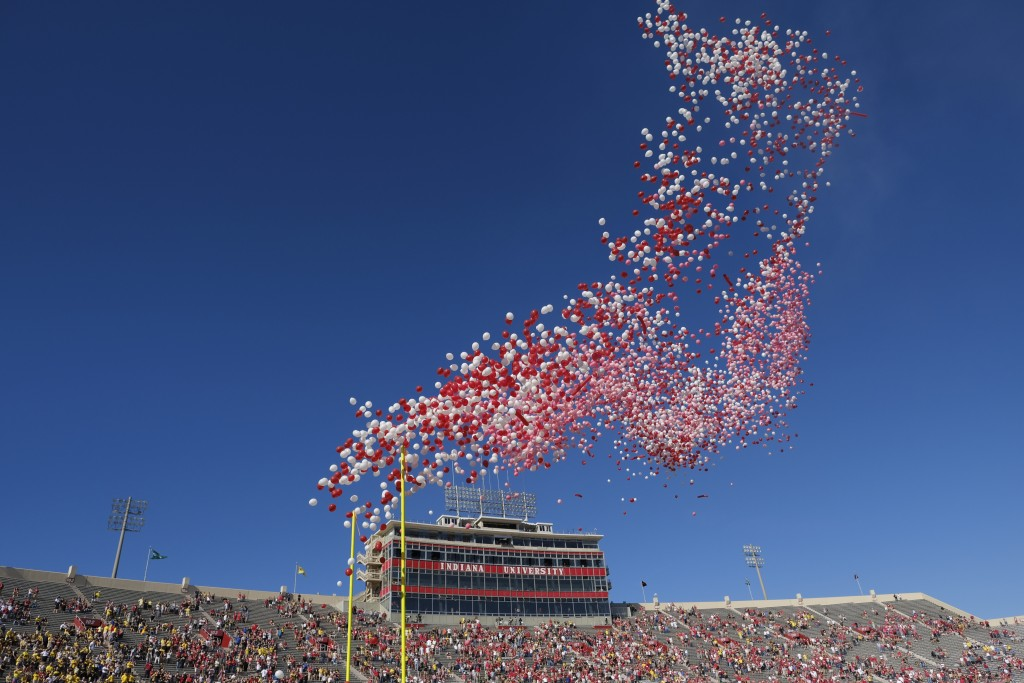 FILE- In this Oct. 14, 2017, file photo balloons are released in Memorial Stadium before an NCAA college football game between Indiana and Michigan in...