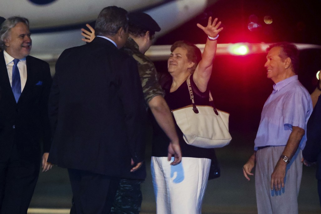 Greek soldiers Dimitros Kouklatzis, center is welcomed by his parents at the airport of the the northern city of Thessaloniki , after spending months ...