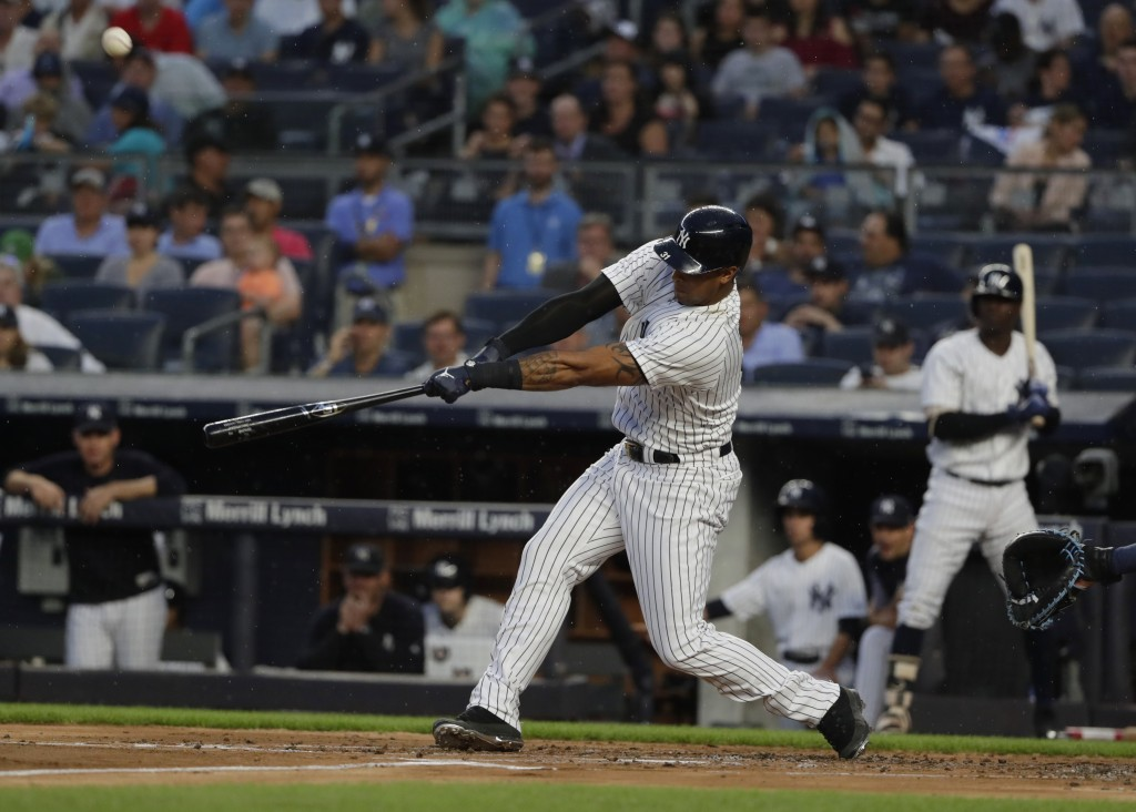 New York Yankees' Aaron Hicks hits an RBI single during the first inning of a baseball game against the Tampa Bay Rays Tuesday, Aug. 14, 2018, in New ...