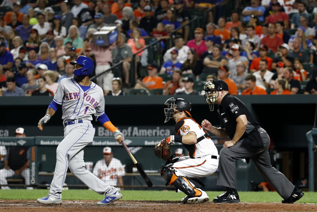 New York Mets' Amed Rosario, left, singles in front of Baltimore Orioles catcher Caleb Joseph and umpire Jeff Nelson in the fifth inning of a baseball...