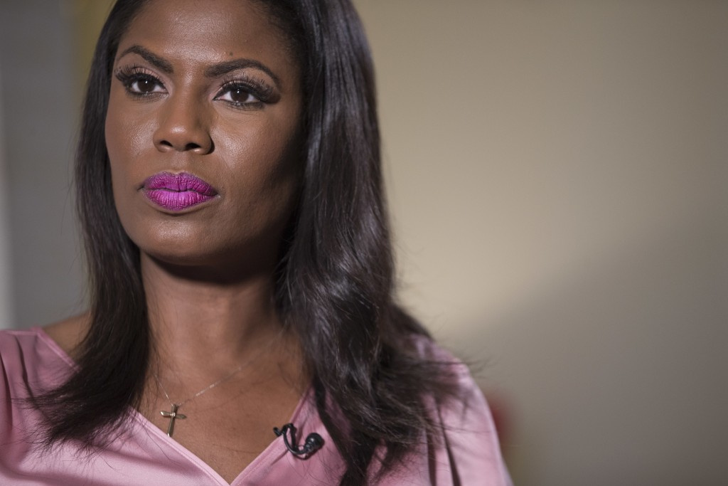 Television personality and former White House staffer Omarosa Manigault Newman listens during an interview with The Associated Press, Tuesday, Aug. 14...