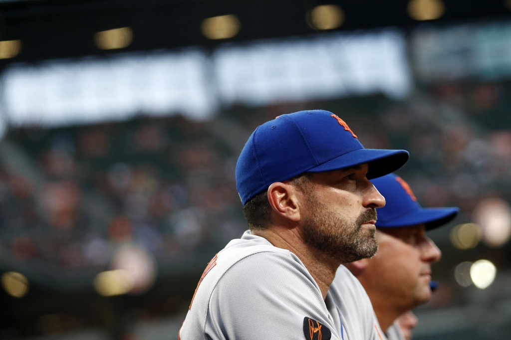 New York Mets manager Mickey Callaway stands in the dugout in the second inning of a baseball game against the Baltimore Orioles, Tuesday, Aug. 14, 20...
