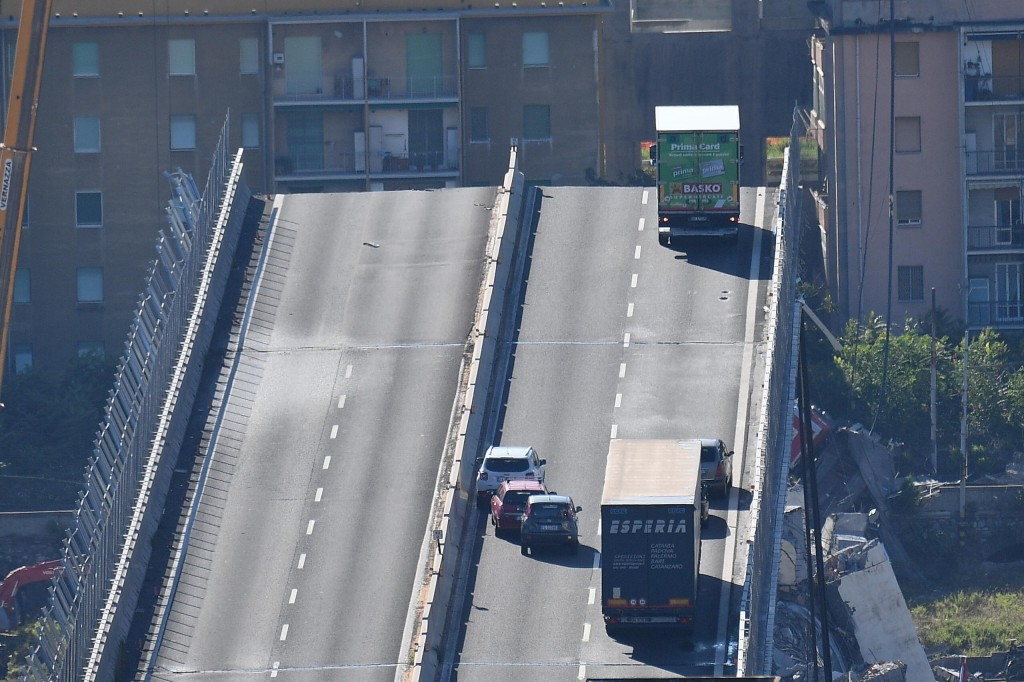 A truck is blocked at the end of the collapsed Morandi highway bridge in Genoa, northern Italy, Wednesday, Aug. 15, 2018. A bridge on a main highway l...