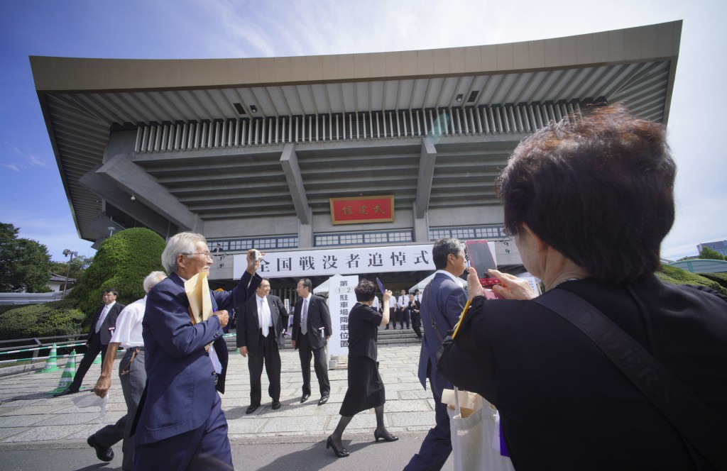 Bereaved family members arrive for a national memorial ceremony for the war dead at Nippon Budokan martial arts hall Wednesday, Aug. 15, 2018, in Toky...
