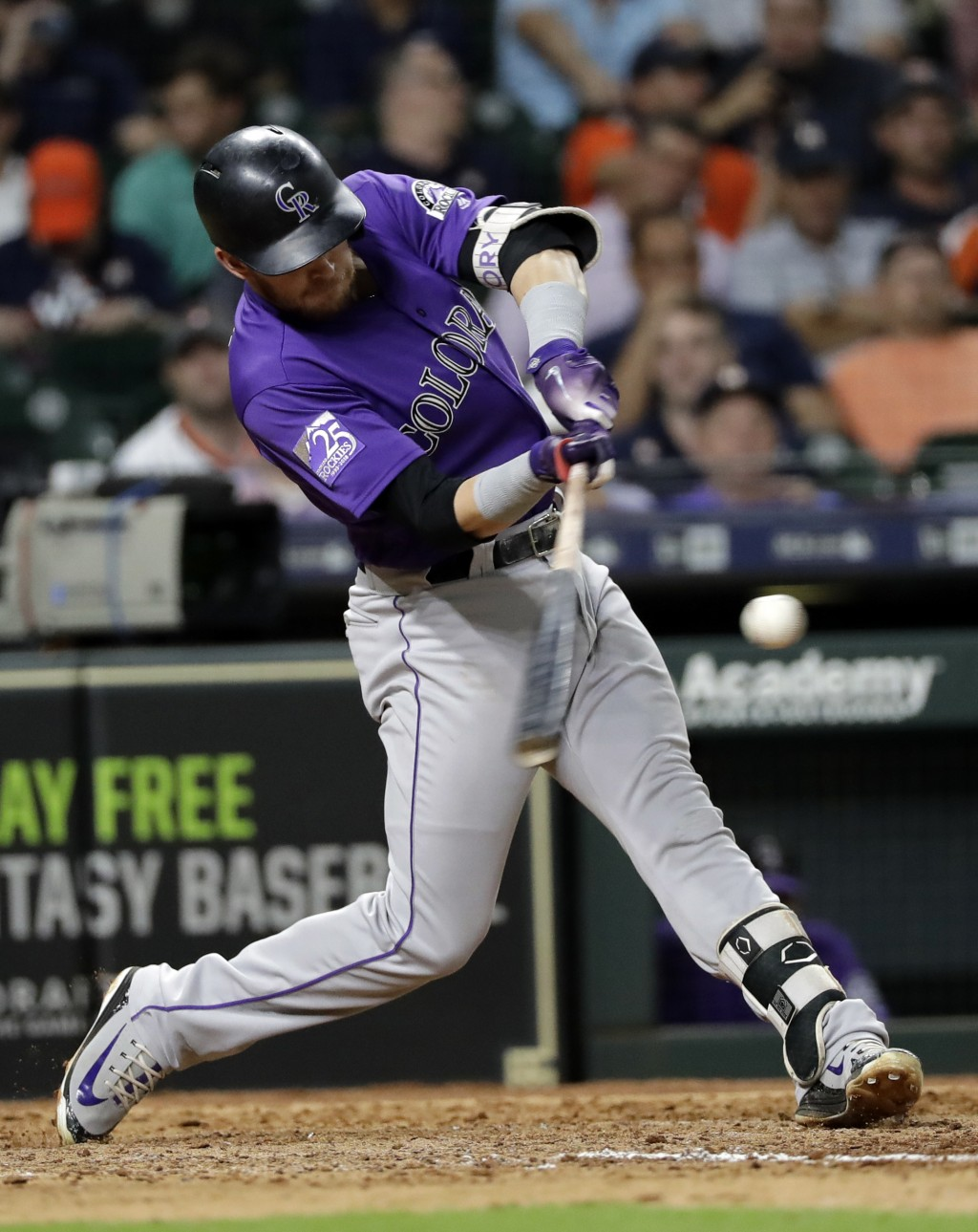 Colorado Rockies' Trevor Story hits a home run against the Houston Astros during the eighth inning of a baseball game Tuesday, Aug. 14, 2018, in Houst...