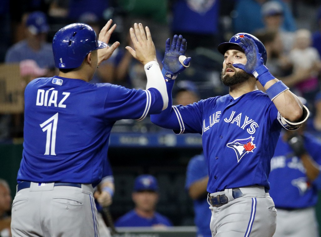 Toronto Blue Jays' Kevin Pillar celebrates with Aledmys Diaz (1) after hitting a two-run home run during the eighth inning of a baseball game against ...