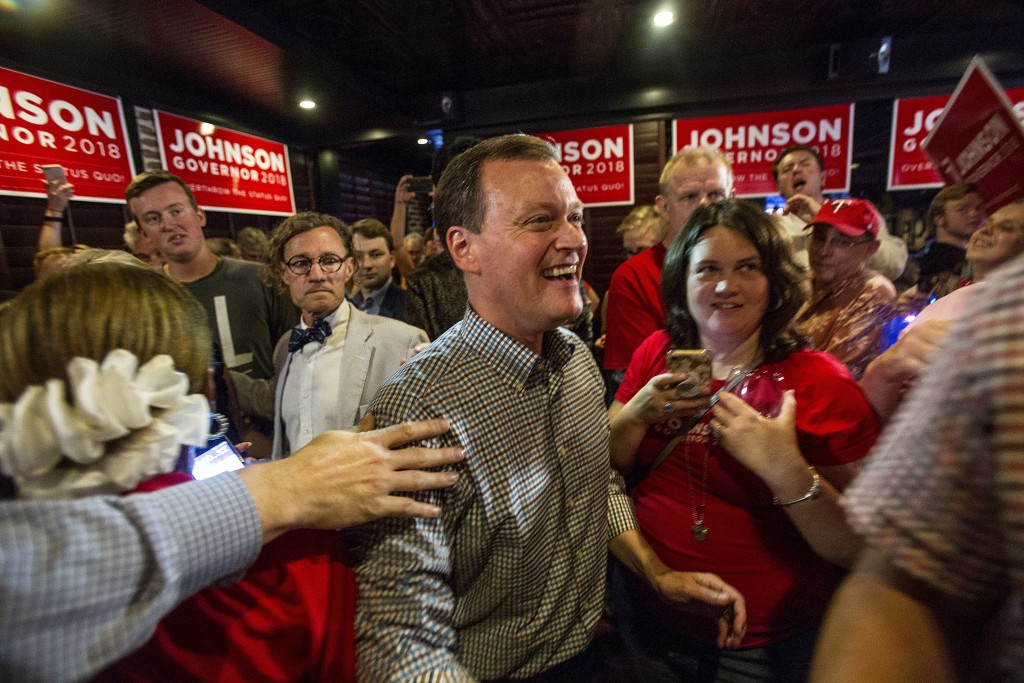 Minnesota gubernatorial candidate Jeff Johnson, center, is greeted by his supporters after returning to the watch party, Tuesday, Aug. 14, 2018, in Pl...