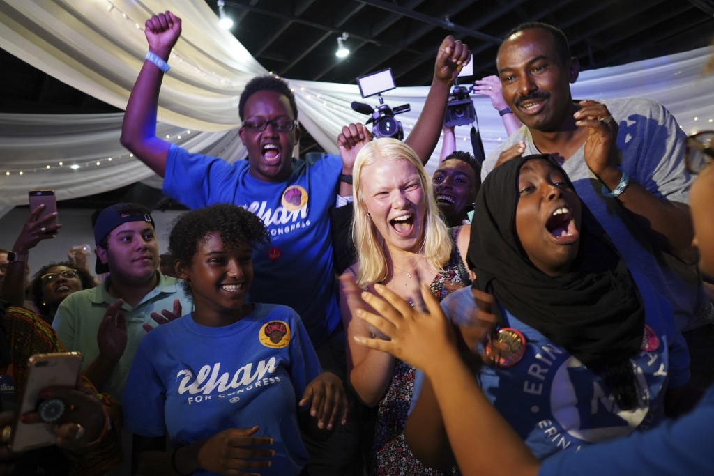Supporters of Congressional District 5 candidate Ilhan Omar gather at Safari Restaurant in south Minneapolis, Tuesday, Aug. 14, 2018. Somali-American ...