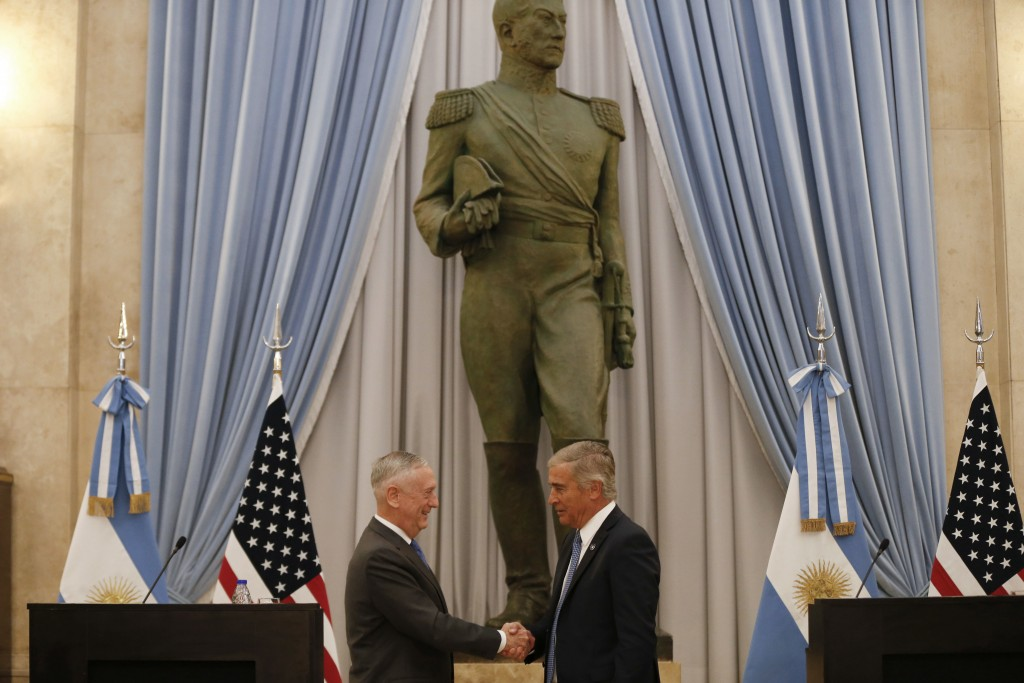 U.S. Secretary of Defense Jim Mattis, left, and Argentina's Defense Minister Oscar Raul Aguad shake hands in Buenos Aires, Argentina Wednesday, Aug. 1...