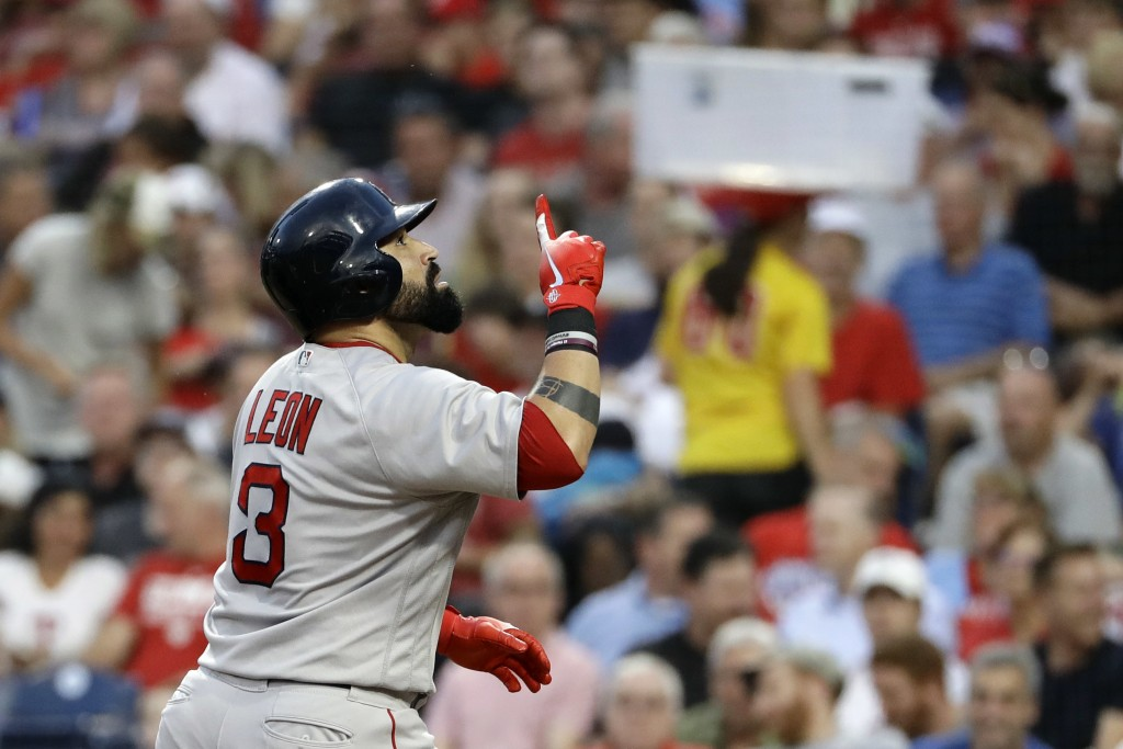 Boston Red Sox's Sandy Leon celebrates after hitting a home run off Philadelphia Phillies starting pitcher Nick Pivetta during the third inning of a b...