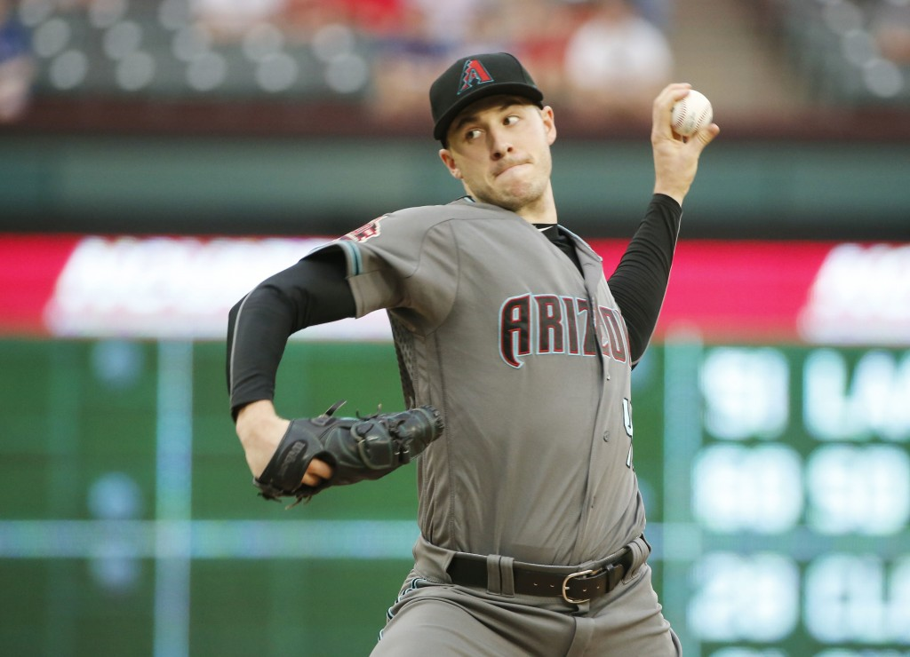 Arizona Diamondbacks starting pitcher Patrick Corbin (46) pitches against the Texas Rangers during the first inning of a baseball game Tuesday, Aug. 1...