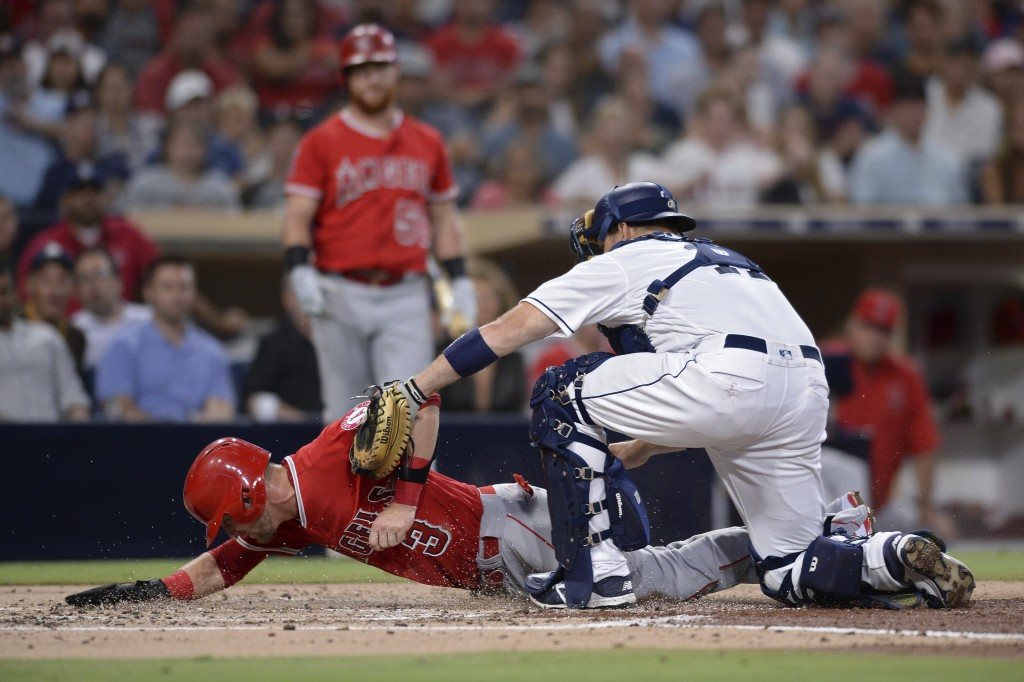 Los Angeles Angels' Taylor Ward (3) is tagged out at home by San Diego Padres catcher A.J. Ellis on a fielders choice hit by Jaime Barria during the s...