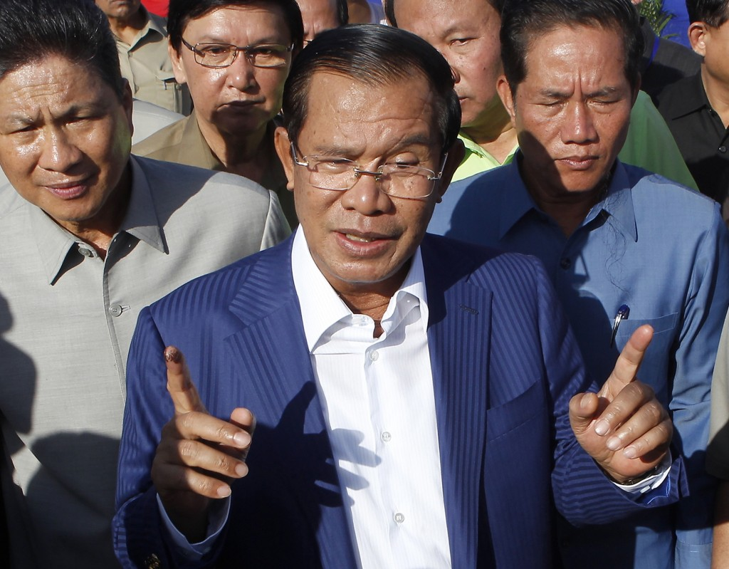 FILE - In this Aug. 1, 2018, file photo, Cambodian Prime Minister Hun Sen gestures while speaking in Phnom Penh, Cambodia. Cambodian Prime Minister Hu...