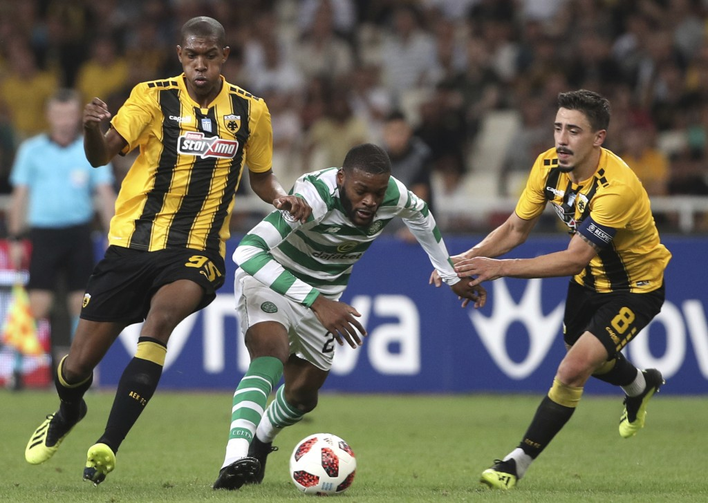 AEK Athens' Alef, left, and AEK Athens' Andre Simoes, right, chase down Celtic's Olivier Ntcham, center, during a Champions League third qualifying ro...