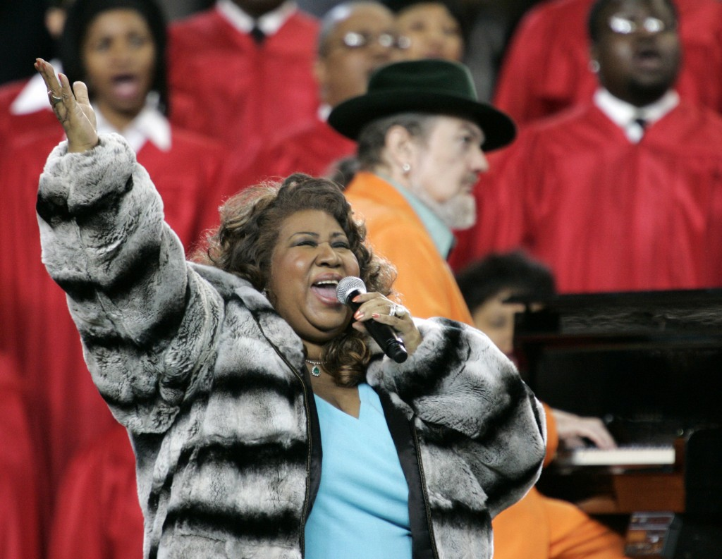 FILE - In this Feb. 5, 2006 file photo, Aretha Franklin and Dr. John, background on piano, perform the national anthem before the Super Bowl XL footba...