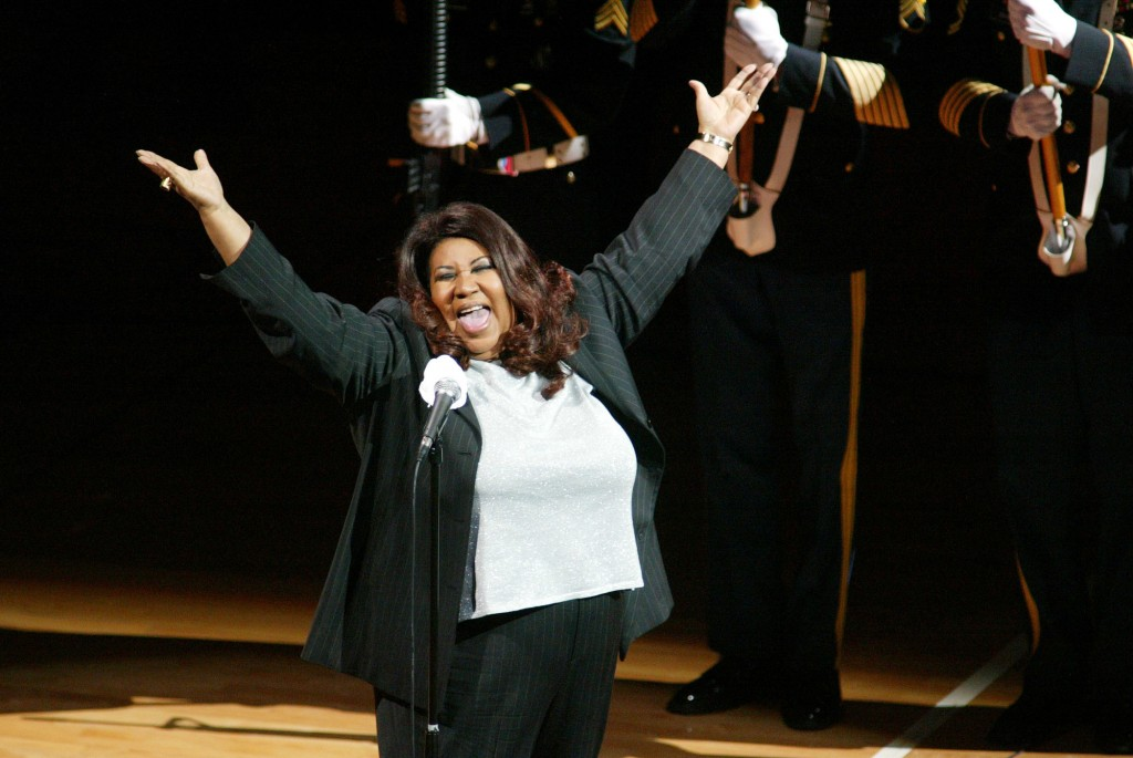 FILE - In this June 15, 2004 file photo, singer Aretha Franklin sings the National Anthem before the start of game 5 of the NBA Finals between the Det...