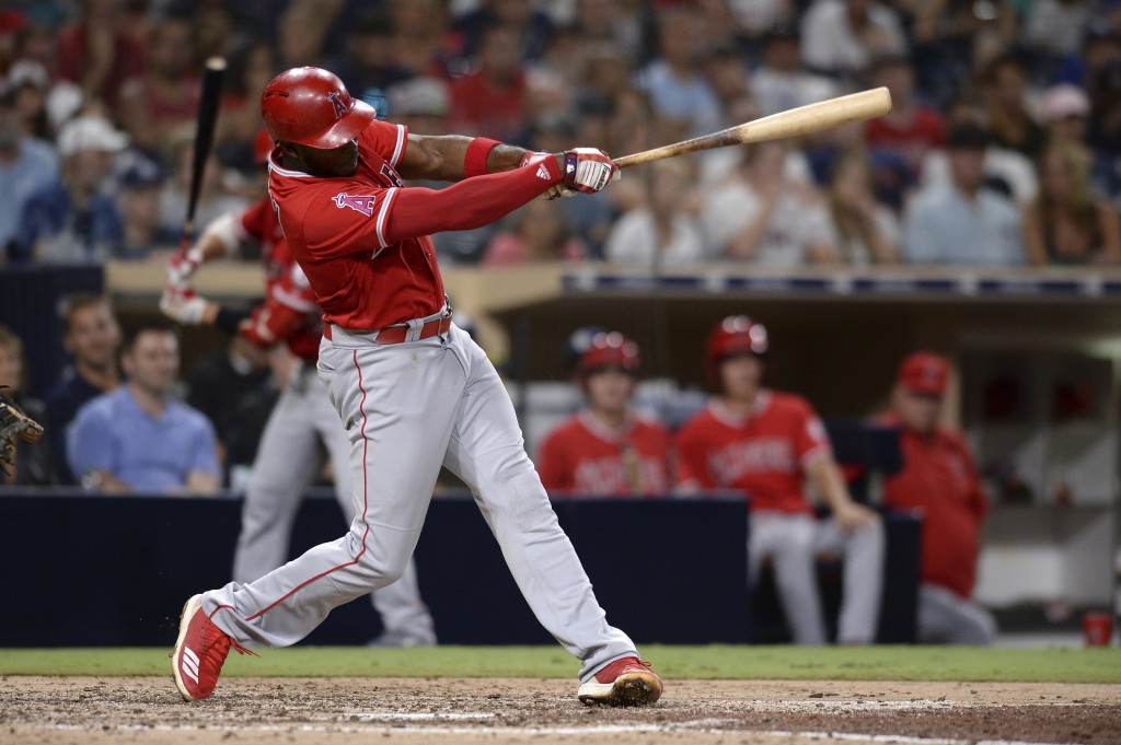 Los Angeles Angels' Justin Upton hits a two-run home run during the fifth inning of a baseball game against the San Diego Padres, Tuesday, Aug. 14, 20...