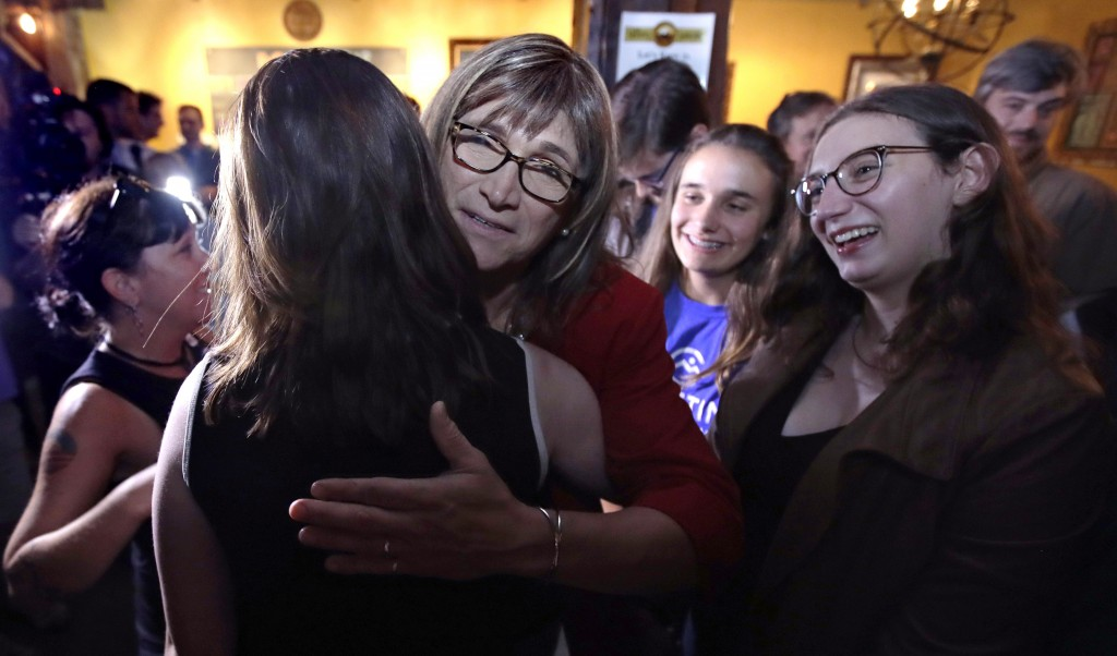 Vermont Democratic gubernatorial candidate Christine Hallquist, center, a transgender woman and former electric company executive, embraces supporters...