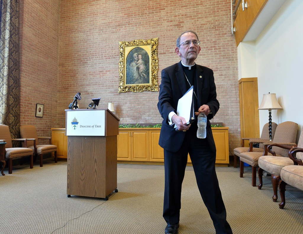 Erie Catholic Bishop Lawrence T. Persico concludes a news conference at the St. Mark Catholic Center in Erie, Pa., on Tuesday, Aug. 14, 2018. In respo...