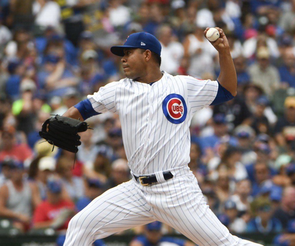 Chicago Cubs starting pitcher Jose Quintana throws the ball against the Milwaukee Brewers during the first inning of a baseball game,Tuesday, Aug. 14,...