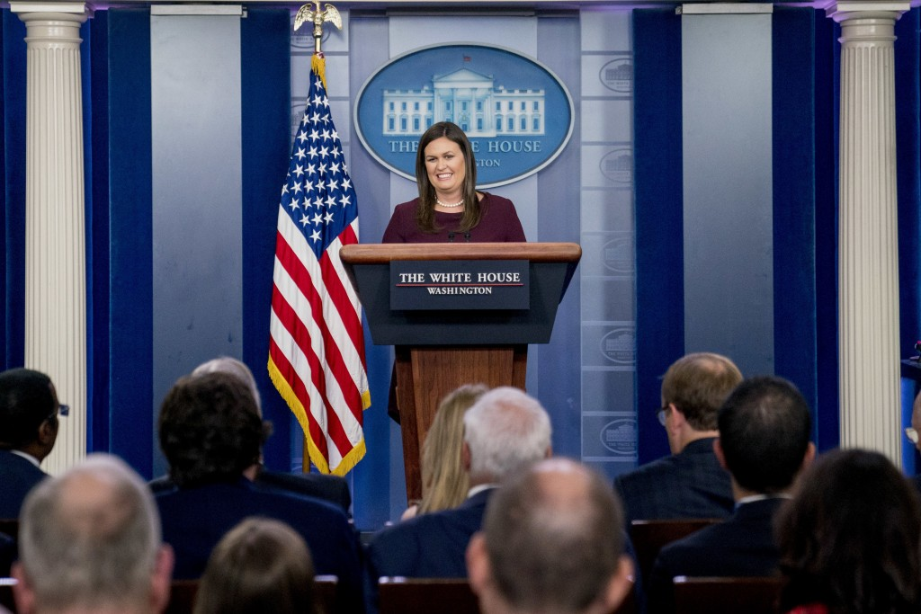 White House press secretary Sarah Huckabee Sanders smiles as she speaks to the media during the daily press briefing at the White House, Tuesday, Aug....