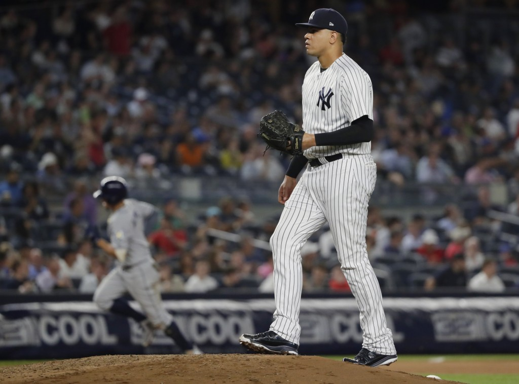 New York Yankees relief pitcher Dellin Betances reacts as Tampa Bay Rays' Willy Adames runs the bases after hitting a home run during the eighth innin...