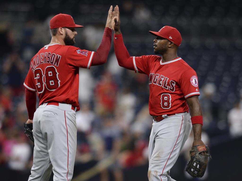 Los Angeles Angels' Justin Anderson and Justin Upton celebrate on the field after defeating the San Diego Padres 7-3 in a baseball game Tuesday, Aug. ...