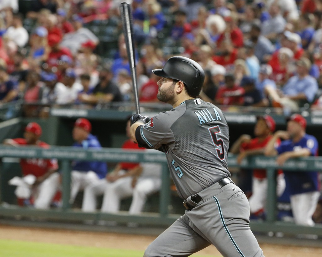 Arizona Diamondbacks' Alex Avila (5) watches the flight of his solo home run against the Texas Rangers during the sixth inning of a baseball game Tues...