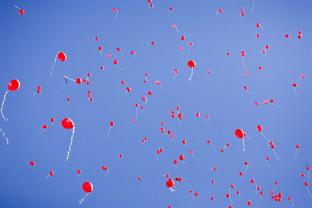 FILE- In this Sept. 11, 2010, file photo red balloons fill the sky after Nebraska scored its first touchdown against Idaho in their NCAA college footb...